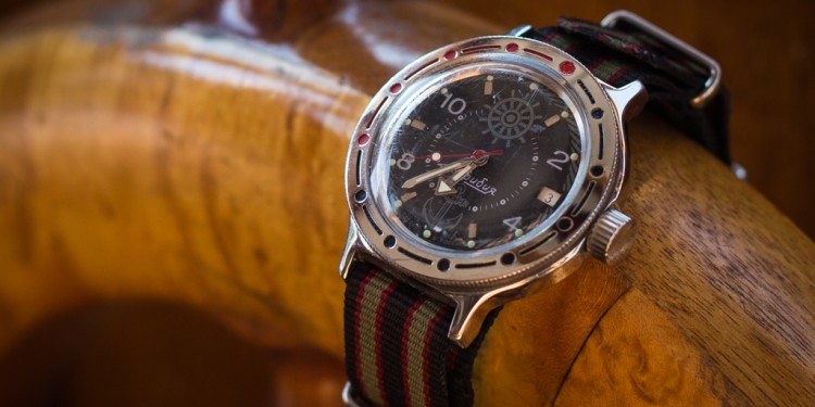 Vostok Amphibia Review – 'Zissou' displayed on wooden steering wheel.