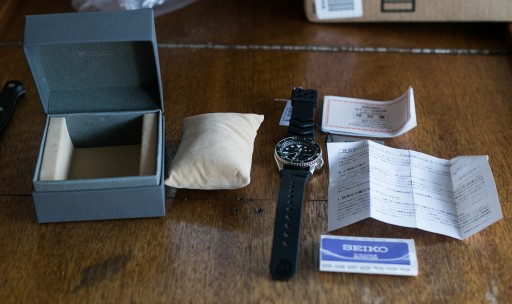 Seiko SKX007 Unboxing - The box included the watch, a soft display pillow, warranty information, and manual.