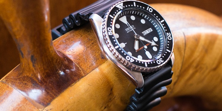 Seiko SKX007 Unboxing - Close shot of SKX007 displayed on ships wheel.